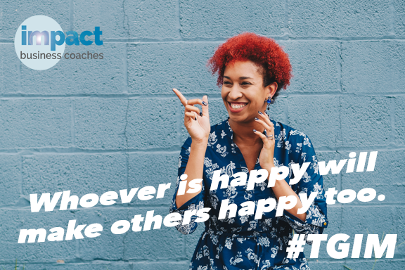 Image of smiling woman pointing to IBC logo with the text whoever is happy will make others happy too. and #TGIM