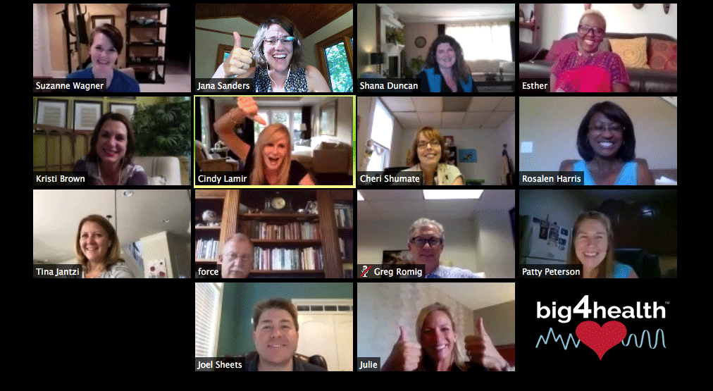 screenshot of 14 pilot participants and coaches on zoom call smiling and giving thumbs up