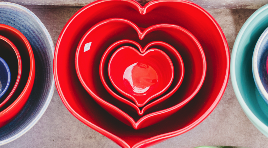 nested bright red, heart shaped mixing bowls